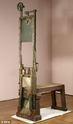 As a warning on the matches being played with, a picture of the guillotine used to judicially murder the Scholls and others